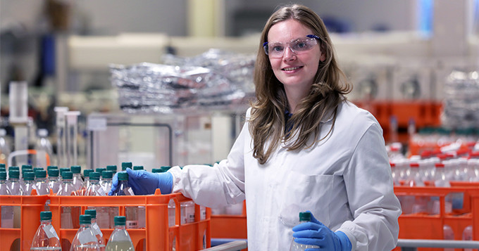 Anglian Water scientist Hayley in the lab with crates of bottled water samples