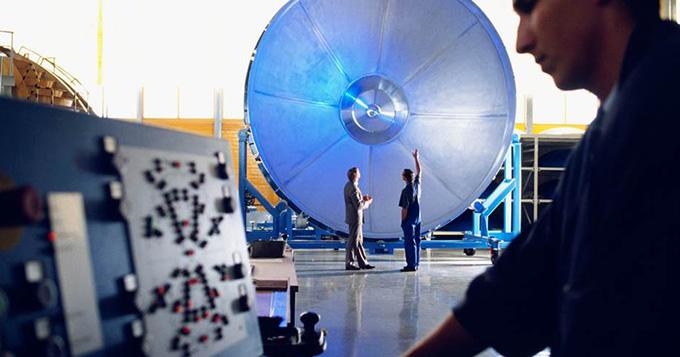 Developer scientist working on a large machine