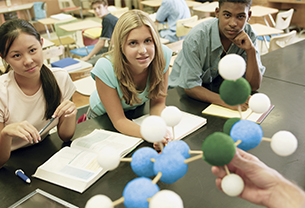 School students in a classroom learning about Chemistry