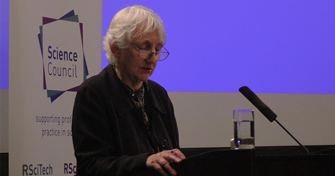 Baroness O'Neill of Bengarve standing at a podium delivering a lecture