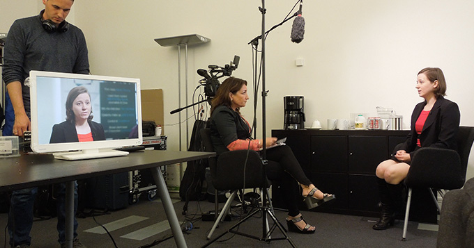 A registrant takes part in media training, being interviewed and filmed in a studio