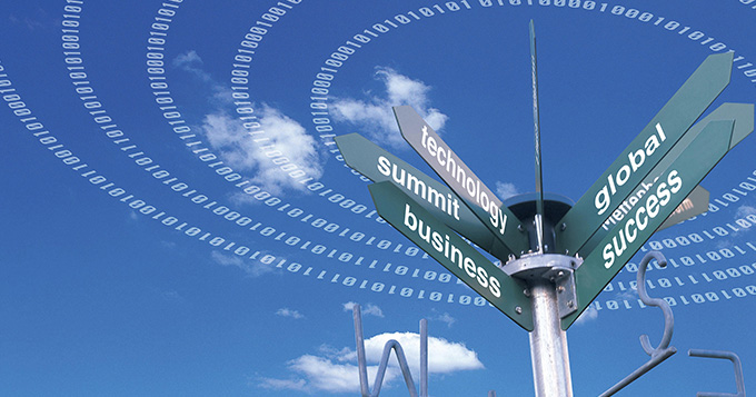 Signpost indicating the words: technology, summit, business, global and success against a bright blue sky with few clouds