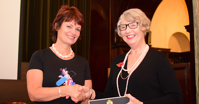 Anne Glover with Carolyn Roberts being presented with the speaker's letter-opener