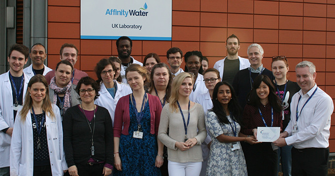 Plaque presentation with group of Affinity Water staff outside their laboratory building