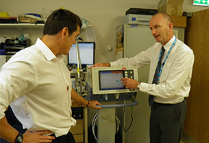 Paul RSci is showing a colleague how to use a medical equipment