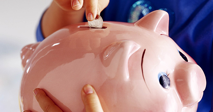 Photo of someone is holding a piggy bank