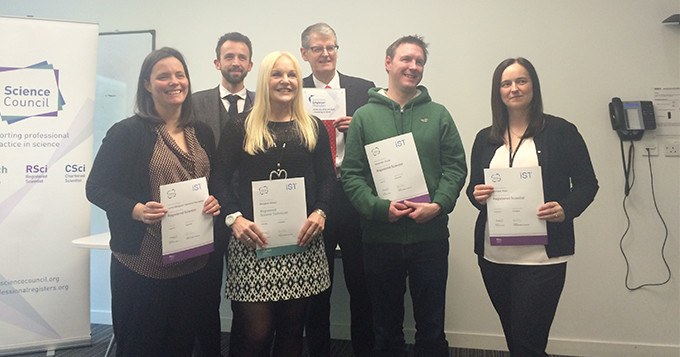 Employer Champion launch event at University of Strathclyde. In the photo are four registrants receiving their registration certificates.