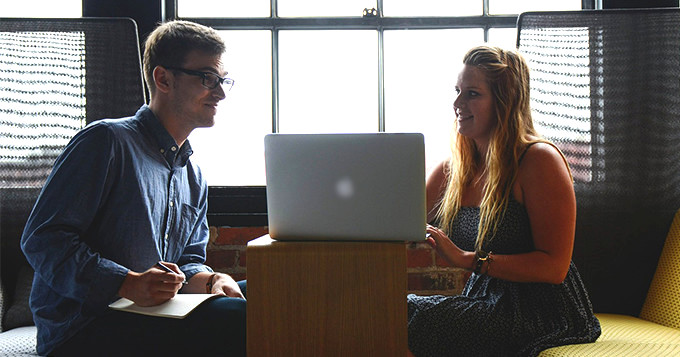 two colleagues having a meeting over a laptop