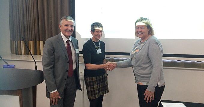 ASPiH is congratulated as a new member with a shake of hands
