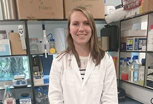 Portrait photo of Registered Scientist Jemma in a laboratory