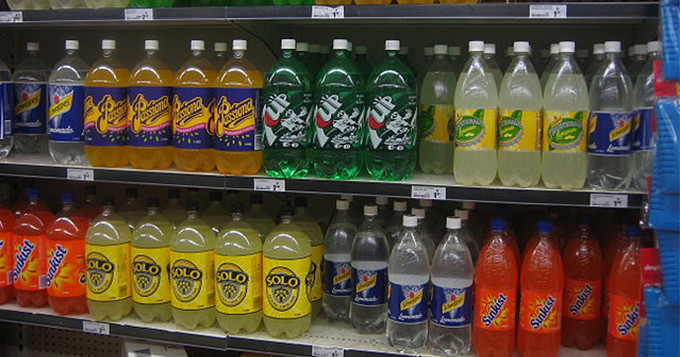 Fizzy drinks bottles on a supermarket shelf