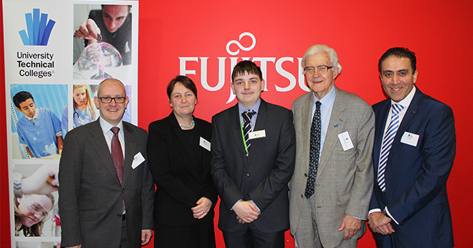 Panel speakers stand in front Fujitsu wall and UTC banner