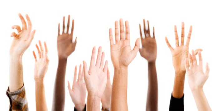 People holding hands up